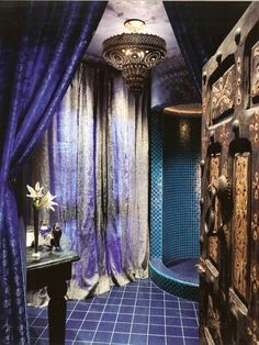 Interesting use of wall length curtains to soften the bathroom space. Bohemian Bathroom Designs 21
