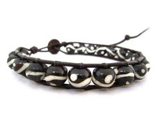 What a cool bracelet! Add it to ya arm! You can't have enough bracelets these days! Yin Yang Bone Leather Wrap Bracelet With by CraeVita on Etsy, $35.00
