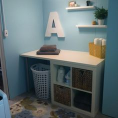 Create a small laundry station with all Ikea items! 1 Expedit box, 3 extendable legs, and 1 countertop!  Add baskets and you are done!