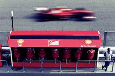 Massa goes past the Ferrari pit wall during the 2013 Malaysian F1 GP