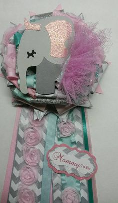 Check out this item in my Etsy shop https://www.etsy.com/listing/236836689/elephant-mommy-to-be-corsage-pink-and