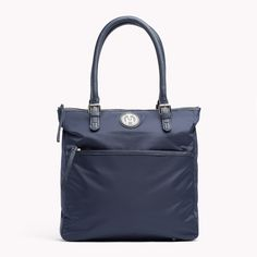 Tommy Hilfiger Chelsea Tote Bag. Nylon tote with leather accents on handles and zipper pullers.