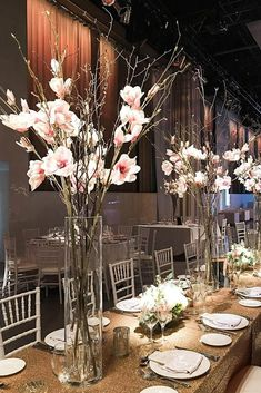 tall wedding centerpieces in a clear even vase wooden branches with pink flowers delight floral design via instagram #weddingflowers