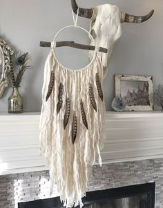 Dream Catcher - Dreamcatcher - Bohemian Decor - Dream Catcher Wall Hanging - Boho Dreamcatcher - Feather Dream Catcher The Mirabelle dreamcatcher is a stunning and dramatic wall hanging. Attached to the front of the ring is a beautiful branch that adds visual interest and an