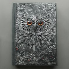 Beautiful owl made with polymer clay on journal cover. I wish I could make this for my next altered book project...