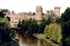 """England's Warwick Castle is known for its haunted Watergate Tower, also known as the """"Ghost Tower."""" Warwick Castle is a breathtaking location overlooking the River Avon.  The most famous ghost said to haunt Warwick Castle is that of Sir Fulke Greville, who was stabbed to death in 1628 by his manservant.  It is said that the castle's Watergate Tower, also known as the """"Ghost Tower"""" is still haunted to this day by Greville and his manservant."""