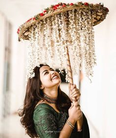 Floral umbrellas are so dreamy and pretty- that adding them to any bridal entry, be it the Engagement, the Mehendi or even your big day is something we highly recommend! Pick a bridal umbrella or a fl. Bridal Portrait Poses, Bridal Poses, Bridal Photoshoot, Desi Wedding Decor, Indian Wedding Decorations, Indian Wedding Favors, Indian Wedding Bride, Ceremony Decorations, Indian Weddings