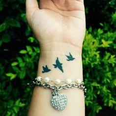 Three little birds on Mayaras wrist.