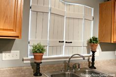White Distressed Kitchen Shutters - ikea bed slats add brace, hardware and indoor shutters from vintage news junkie