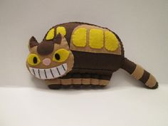 Cat Bus Plush Inspired by My Neighbor Totoro. He is made out of Felt, Stuffed then Hand Sewn with matching Embroidery Thread. Made with a lot of