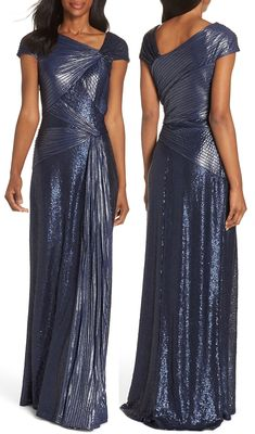 Densely sewn sequins enhance the metallic pintucked fabric of this truly regal winter wedding bridesmaids dress. Tadashi Shoji Pintucked Bridesmaids Dress. Navy Bridesmaids Dress for Winter Wedding. Bridesmaids Outfits for Winter Weddings. Winter Wedding Ideas 2020. Winter Wedding Dresses. Navy Long Bridesmaids Dress. Navy Mother of the Bride Dress USA 2020. What to wear to a Winter Wedding. Winter Bridesmaids Ideas . Christmas Wedding Bridesmaids 2020. #bridesmaids #bridesmaidsdress… Navy Bridesmaid Dresses, Bridesmaid Outfit, Wedding Dresses, Winter Wedding Bridesmaids, Formal Wear, Formal Dresses, Cocktail Hat, Bridal Outfits, Bridal Headpieces