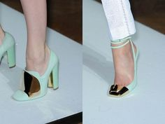 These gold toed, mint green strappy flats are so strange but chic. The pumps are kinda funky too