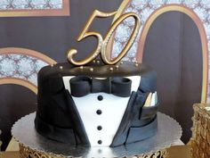 Great cake at a black and gold tuxedo party! See more party planning ideas at CatchMyParty.com!