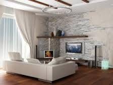 weiße Verblendsteine und dunkle Wohnzimmermöbel | rivestimento ...