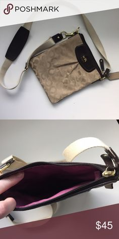 Coach Crossbody Purse Brown and beige crossbody with adjustable strap, zip closure, outer pocket, and pink satin lining. Used just a few times, excellent condition. Coach Bags Crossbody Bags