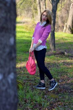 Love this pink sweater. polka dot shirt and not to forget the sneakers that are…
