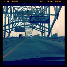 """The world's largest """"M"""" shaped bridge which happens to cross the powerful Mississippi river at Memphis Tennessee. viewed from the west looking eastward from Arkansas"""