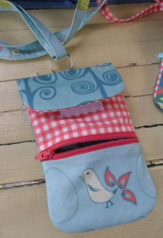 """A free downloadable sewing pattern to print and sew a Smart Phone wristlet bag or carrying case. Debbie from """"Wow I LIke That"""" designed this very practical bag for a cell phone. #sewing"""