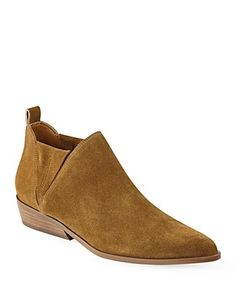 Kendall and Kylie's suede booties hit the town in boho-chic suede, while a pointed-toe silhouette gives them feminine shape.