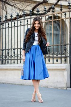 Spring Outfits 2015: 50 Flawless Looks to Copy Now - an electric blue satin midi skirt worn with a graphic tee + edgy leather jacket and ankle strap heels