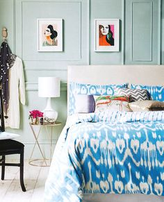 I love everything about this - mixed print bedding, colorful prints, that GORGEOUS wall color, mint julep cup full of flowers!