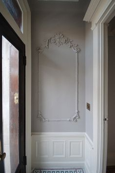 Vestibule with bone white wainscoating, walls lovely silver fox