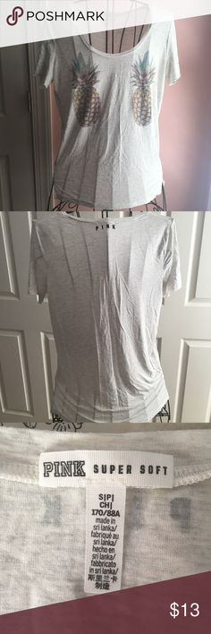 Pink 🍍 T-Shirt Cute Pineapples on the front! Color is a mix between a white and grey! Super soft!! Worn once! Open to Offers 🤑! No Trades 🚫! PINK Victoria's Secret Tops Tees - Short Sleeve