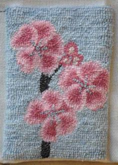 Aya Ohashi of Japan is hooking this lovely cherry blossom clutch purse - 2012