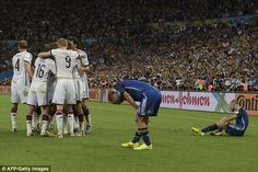 On the floor: Mascherano (right) and Pablo Zabaleta (centre) are dejected after the World . World Cup Final, World Cup 2014, Finals, Centre, Soccer, Floor, Sports, Life, Pavement