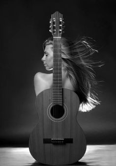 Gabor Kanovits - Girl With Guitar - Picture Of The Day - ONE EYELAND  2013-04-15