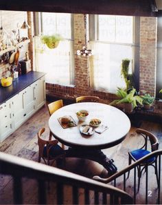 This must be one of those awesome urban lofts you always see in movies.  The brick, the wood, the cobalt blue, let me in immediately to this warm, cozy kitchen!