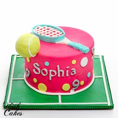 Tennis theme 9th birthday cake. The cake is decorated in hot pink fondant with a tennis racket and a tennis ball. The cake board decorated in tennis field shape.