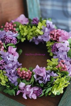 Very pretty floral wreath in lavender, pinks, and lime