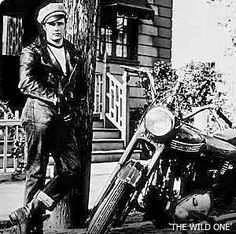 "Influence - Marlon Brando in ""The Wild One"" Tho Triumph motorcycles were used in the movie, its a good example of the type of Motorcycle Counter Culture that spawned after WWII that Harley Davidson had such a large influence on from the begining. (fullboremotorcycles, 2012)"