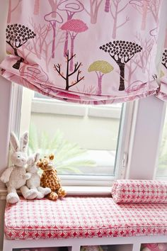 Such a cute window seat for a little girl! If you look carefully the bench is not built in it could even be an Expedit shelf - you could easily recreate this in any window!