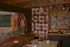 Window quilt patchwork  I can remember my Grandmother and Great Grandmother putting quilts over windows and doors in the winter.