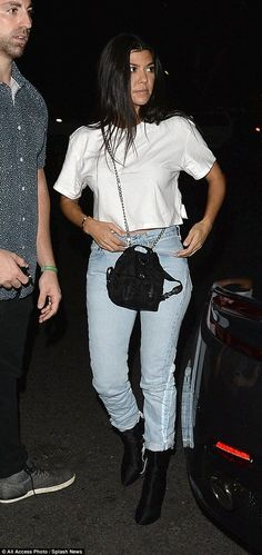 Comely and casual: The Keeping Up With The Kardashians star went with a simple ensemble for the midweek service