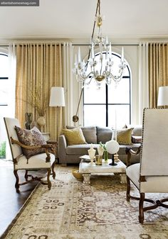 Charisma Design ( like the look of the chandelier with electrical cord hooked on wall)