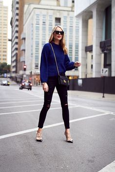 Fall Outfit, Navy Oversized Sweater, Gucci Marmont Handbag, Black Celine Sunglasses, Frame Denim Black Ripped Skinny Jeans, Valentino Rockstud Pumps