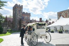 """Stone wedding venue and white carriage that says """"Just Married"""""""