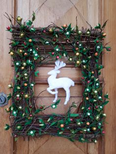 Winter/Christmas handmade wreath by Luana Savioli. Deer except, this wreath is all handmade: berries too.