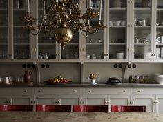 Brass works here to add vintage history and a formal air (as well as chandelier)to a more modern farmhouse kitchen.