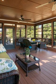 Three season porch with Eze-Breeze® windows. Back porch designed and built by Atlanta Decking & Fence.