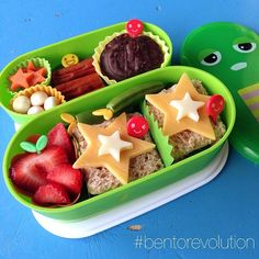 """Bento for Mr. P on this rainy Wednesday...mortadella and spinach sandwiches on whole wheat with cheese stars on top, strawberries, snap peas, carrot…"""