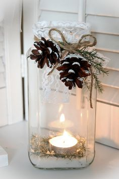 Adaptable to a wedding table mason jar with candle inside. greenery, pinecones and twine tied on. Great down banquet tables with a burlap runner at christmas time