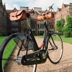 Leather Handlebar Bag. So adorable. Oh, and I'd so be caught wearing a short red gingham dress riding this beauty.