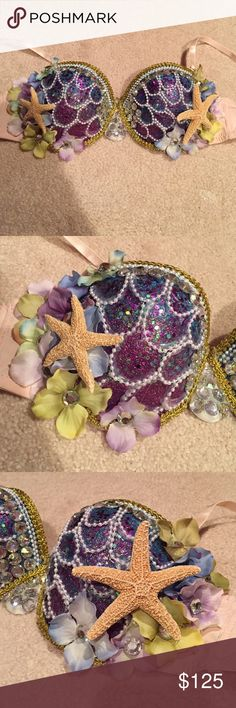 Never worn handmade mermaid rave bra size 32D Never worn handmade mermaid rave bra size 32D. Could be strapless. I made this for a festival but then I decided I wanted to wear a different mermaid bra. It's pretty heavy duty because of the amount of stuff on it. I individually glued on the pearl strings to form the shell design. Beautiful flower with rhinestone accent and details on the sides. Two large starfish glued on the side. Gold metallic ribbon glued on top and bottom of cup to outline…