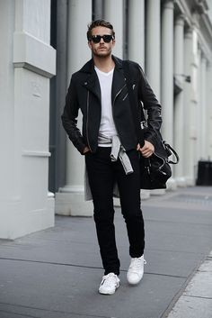 Go Black Go Sexy in Black Biker Jacket, White T-shirt, Grey Sweater, Black Messenger Bag, a pair of Black Skinny Jeans and White Sneakers