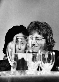 """ Yoko Ono and John Lennon in Syracuse, N.Y. on Oct. 9, 1971 during the press conference for Ono's solo exhibition. It was also John Lennon's birthda. Photo by Leroy Woodson. """