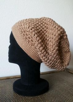 Handmade slouchy hat. Measures aprox. 21 inches in diameter. Can be made to fit (specify the measure of your head). As always made with love in every stitch!!! $20  This awesome pattern is courtesy of: http://meladorascreations-com.webs.com/